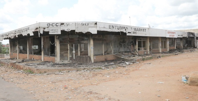 'Looting spells death for Zimbabwe retailers'